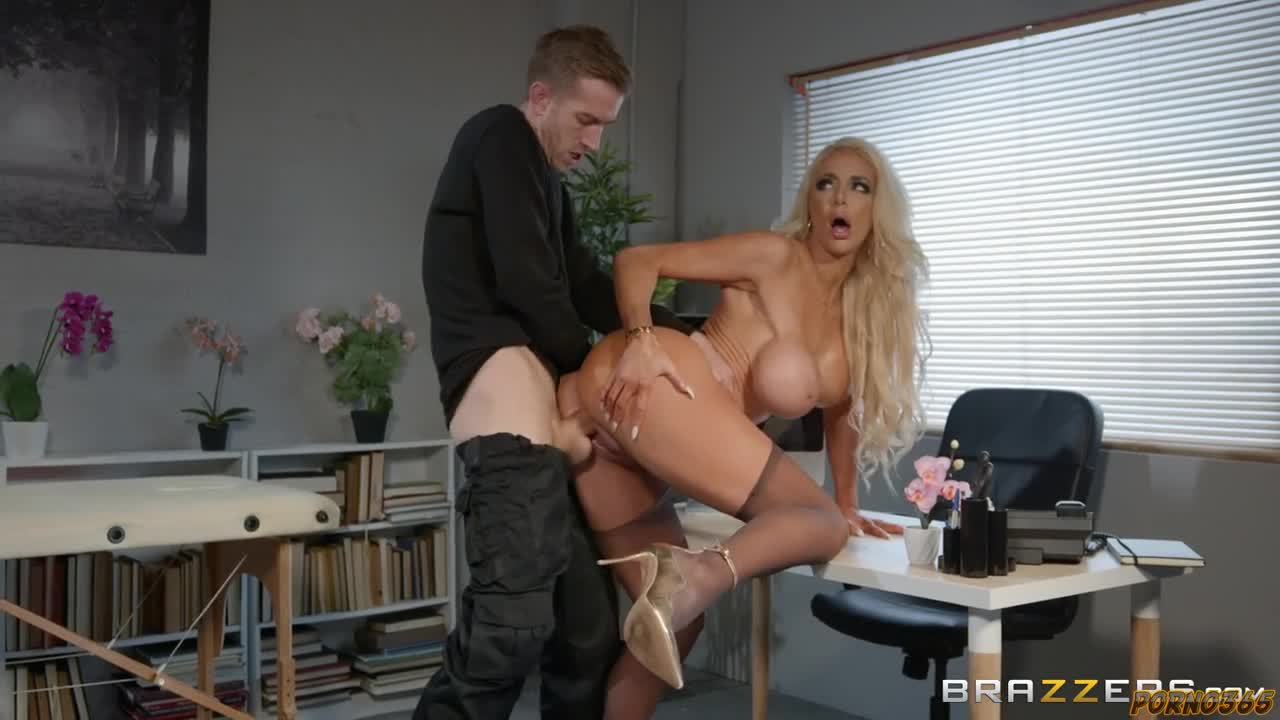 At work in the office makes the blonde a light back massage and Fucks hard her big fuck